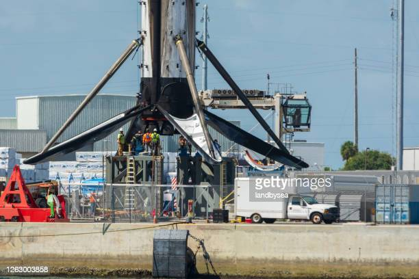 spacex rocket being lifted by crane - dockers brand name stock pictures, royalty-free photos & images
