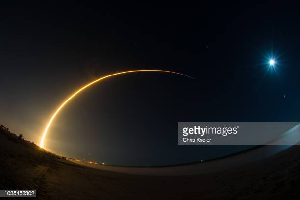spacex's 50th falcon 9 rocket launches from cape canaveral, florida, as moon looks on - space exploration stock pictures, royalty-free photos & images