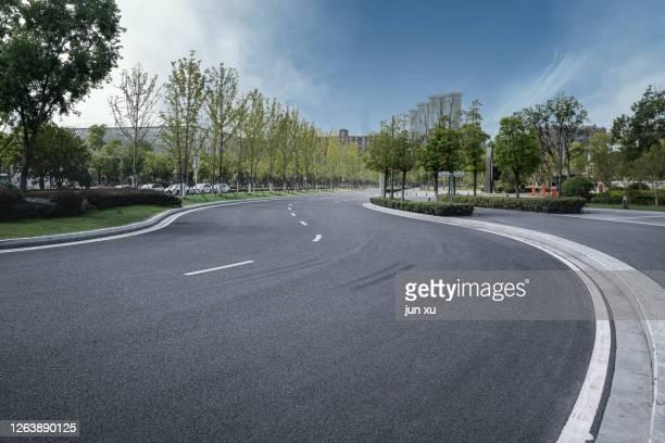 spacious and bright future urban architectural space platform road, 3d rendering - nanjing road stockfoto's en -beelden