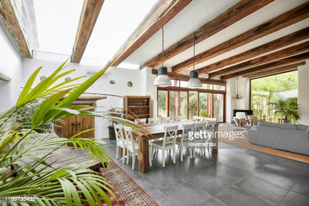 spacious dining area in a bright refurbish mediterranean farmhouse - ceiling stock pictures, royalty-free photos & images