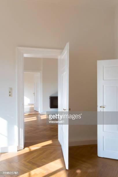 spacious empty flat with herringbone parquet - herringbone floor stock photos and pictures