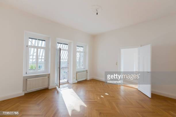 Spacious empty flat with herringbone parquet