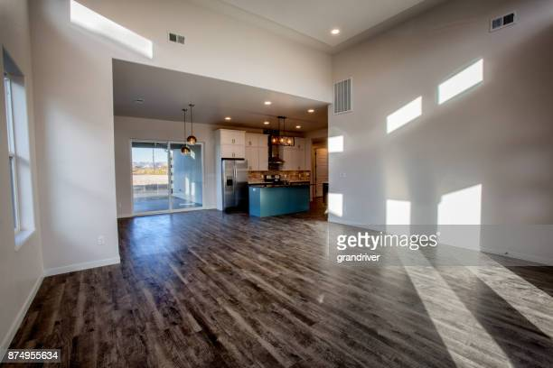 spacious living room and kitchen in a new house - hardwood stock pictures, royalty-free photos & images