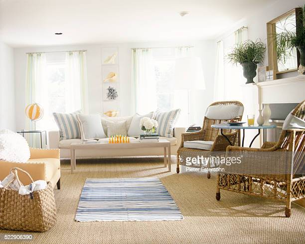 Spacious living room with orange and blue accents