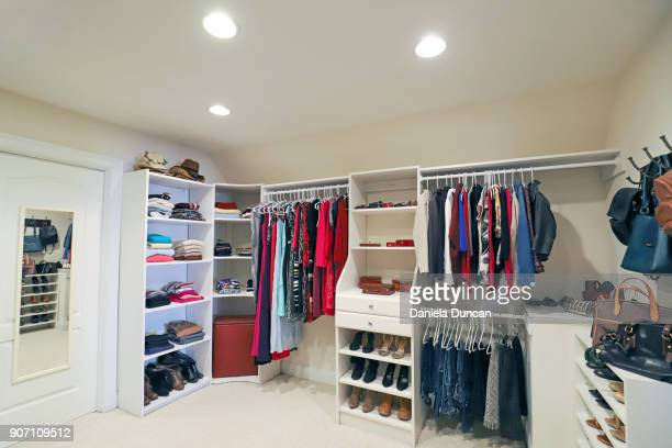 spacious walk-in closet - walk in closet stock photos and pictures