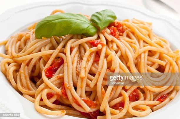 spaghetti al sugo with tomato and basil - marinara stock photos and pictures