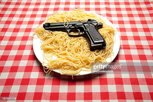spaghetti and gun - mob stock photos and pictures