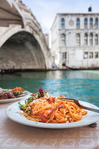 Spaghetti at the Rialto Bridge, Venice. 155437792