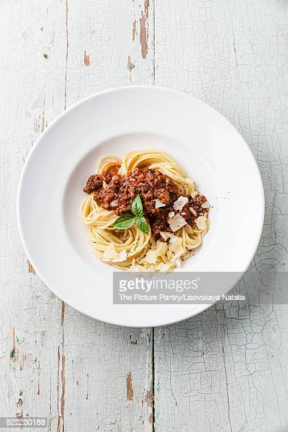 Spaghetti Bolognese on blue wooden background