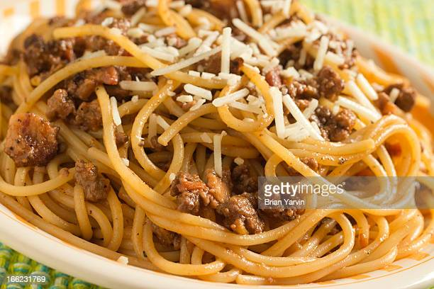 Spaghetti bolognese with shredded cheese
