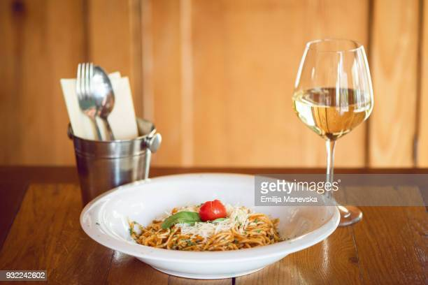 Spaghetti, cheese and cherry tomatoes in a plate