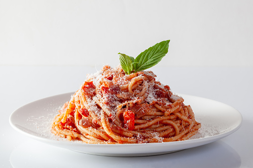 Spaghetti in a dish on a white background 1144823591
