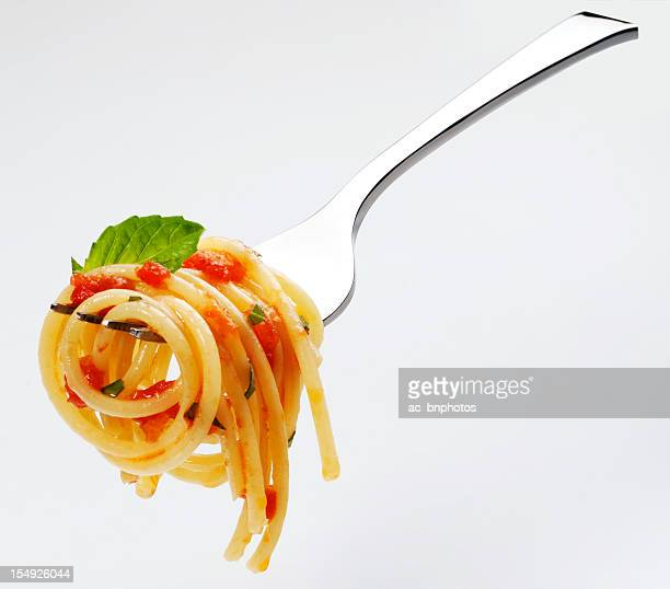 spaghetti tomato sauce and basil - fork stock pictures, royalty-free photos & images