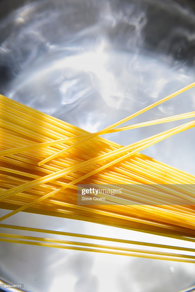 Spaghetti waiting for water to boil : Stock Photo