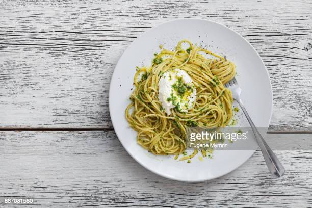 spaghetti with cavolo nero pesto and goat curd - whole wheat stock pictures, royalty-free photos & images