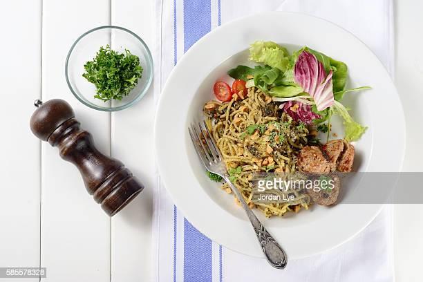 spaghetti with meatballs and pesto sauce