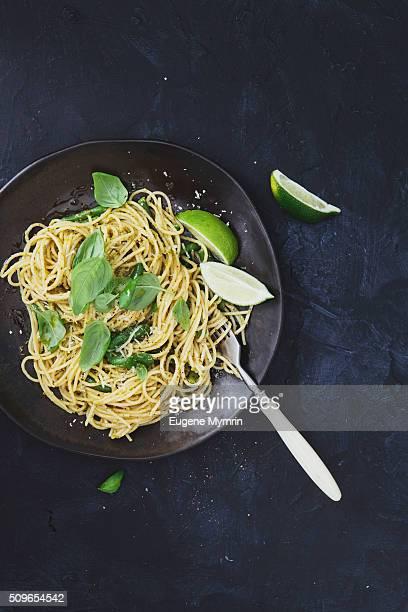 Spaghetti with pesto sauce, haricot and basil