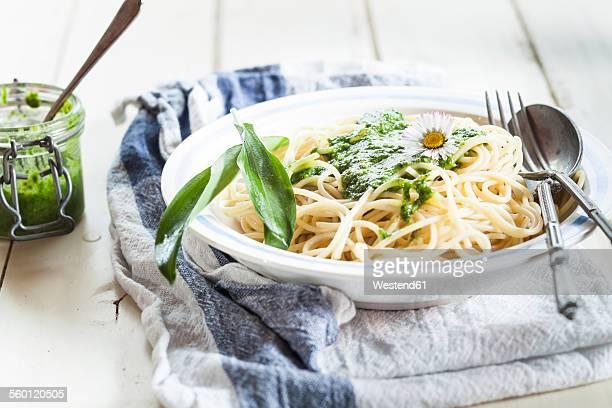 Spaghetti with ramsons pesto, wild garlic leaves