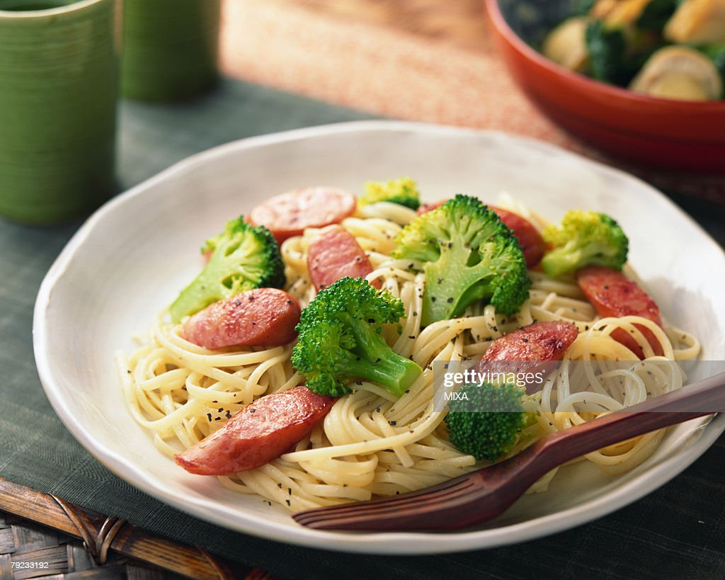 Spaghetti with sausage and broccoli : Stock Photo