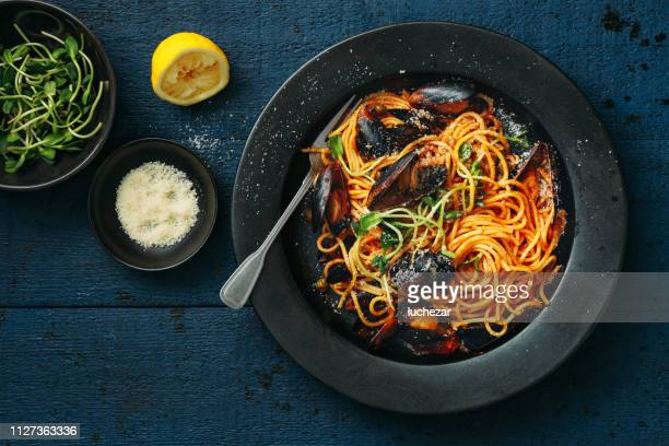 spaghetti with smoky tomato & seafood sauce - mussel stock pictures, royalty-free photos & images