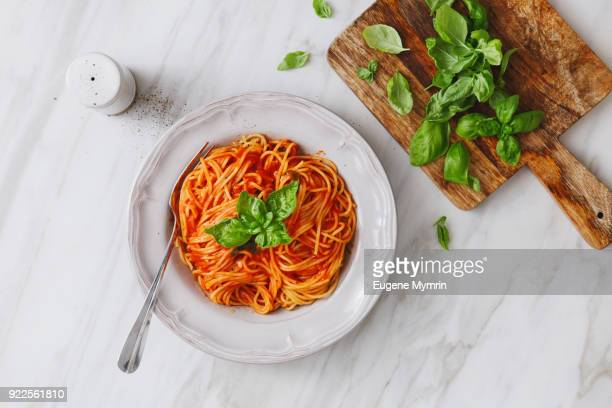 spaghetti with tomato sauce - tomato sauce stock pictures, royalty-free photos & images