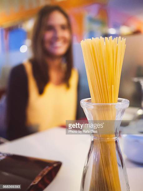 Spaguetti in glass pasta jar and smiling woman