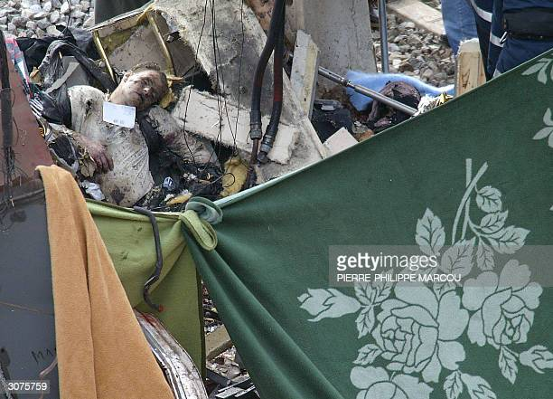 a body lays among the debris of a train after it exploded at the Atocha train station in Madrid 11 March 2004 At least 185 people were killed and...
