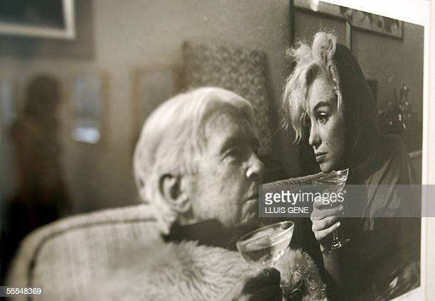 A visitor looks at photos of US actress Marilyn Monroe taken by photographer Arnold Newman at an exhibition about the final days of Monroe 15...