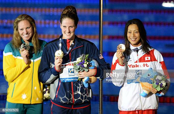 BARCELONA Spain American Missy Franklin Emily Seebohm of Australia and Aya Terakawa of Japan show their gold silver and bronze medals respectively in...