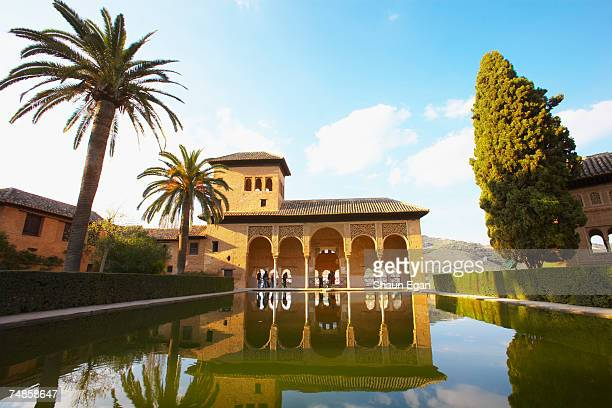 Spain, Analucia, Granada, Alhambra Palace, Damas tower building reflected in pool