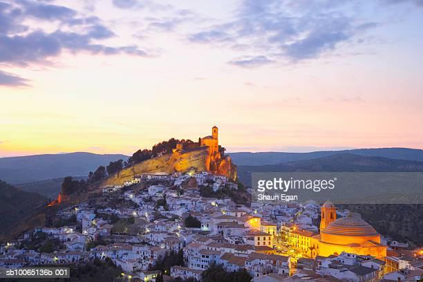 Spain, Andalucia, Granada, town on hillside at dusk