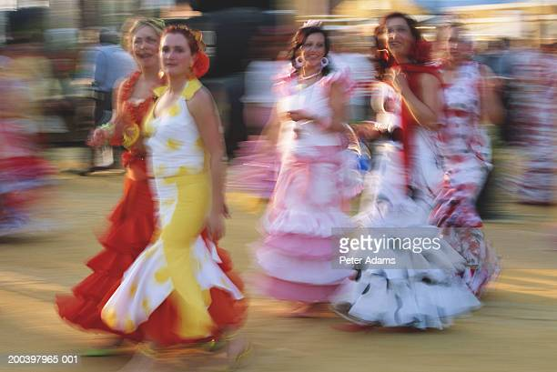Spain, Andalucia, Seville, flamenco dancers walking (blurred motion)
