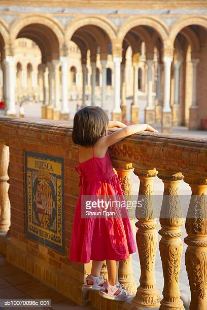 spain, andalucia, seville, plaza de espana, girl (4-5) climbing on balustrade - seville stock pictures, royalty-free photos & images