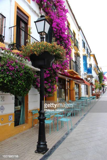 spain, andalusia, málaga province, marbella, old town, flowery street - old town stock pictures, royalty-free photos & images