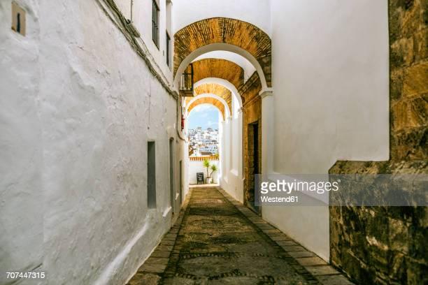 spain, andalusia, vejer de la frontera, picturesque alley callejon de las monjas - callejon stock pictures, royalty-free photos & images