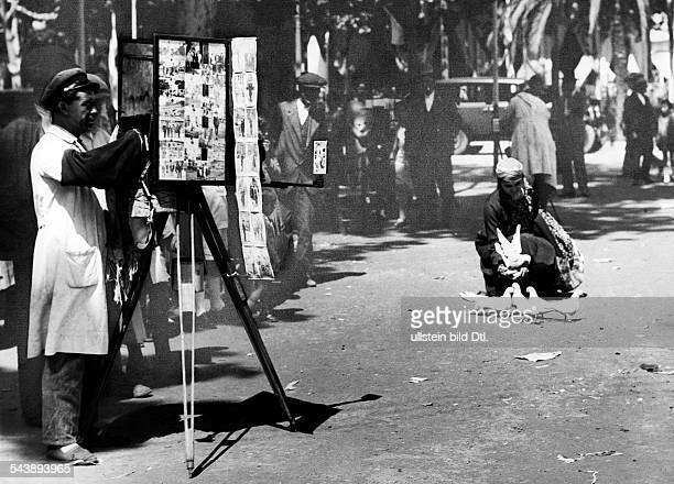 Spain Andalusien Andalucia Jerez de la Frontera street photographer photographing a woman with white dove Photographer Martin Munkacsi 1930Vintage...