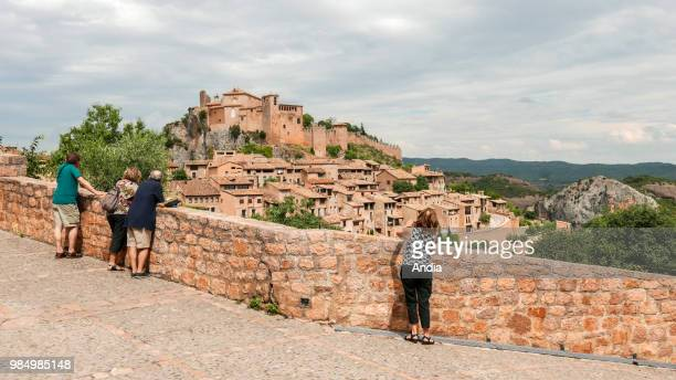 Alquezar, small restored medieval village surrounding a former monastery set high up on a rock spur of the Sierra de Guara, on the Rio Vero. Tourists...