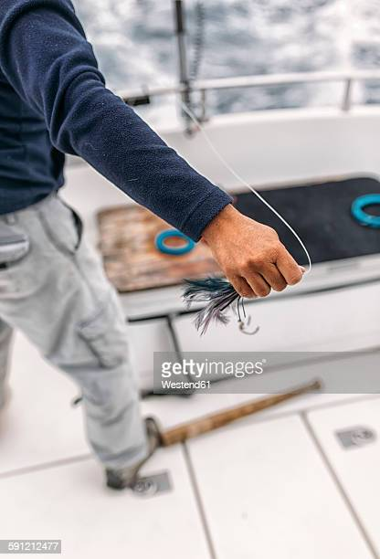 Spain, Asturias, Fisherman holding bait