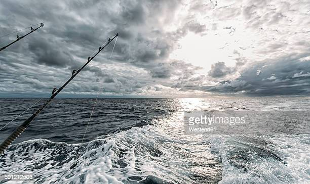 Spain, Asturias, Fishing rods on fishing boat