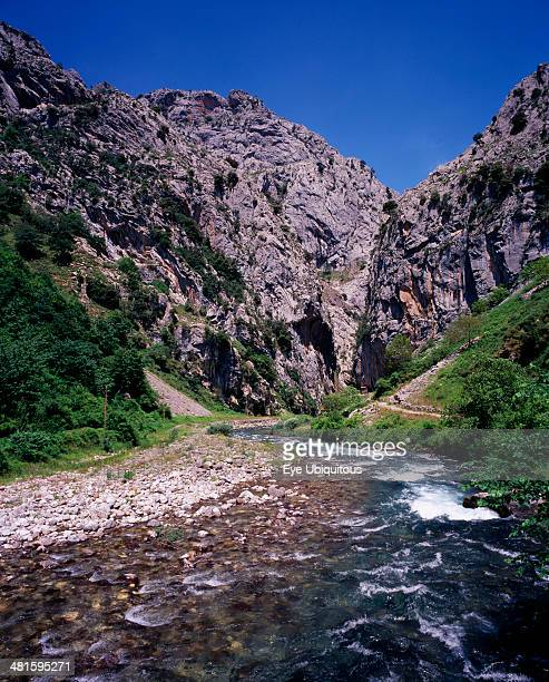 Spain Asturias Picos de Europa Garganta del Cares Rio Cares flowing towards gorge from the south Shallow fast flowing water over rocks with steep...