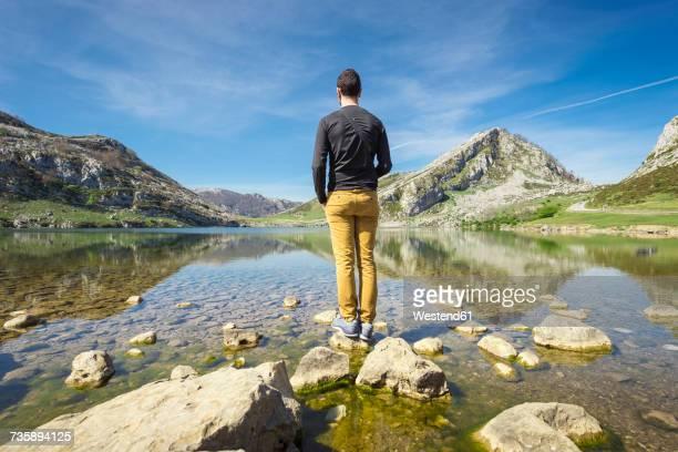 Spain, Asturias, Picos de Europa National Park, man standing at Lakes of Covadonga