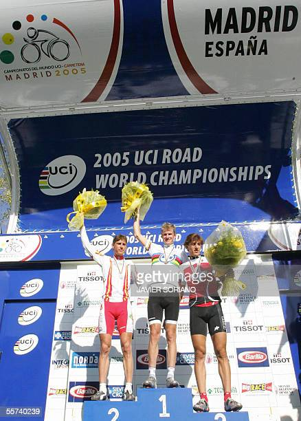 Australia's Michael Rogers Spain's Ivan Gutierrez and Swiss Fabian Cancellara celebrate on the podium after the men's time trial race at the 2005 UCI...