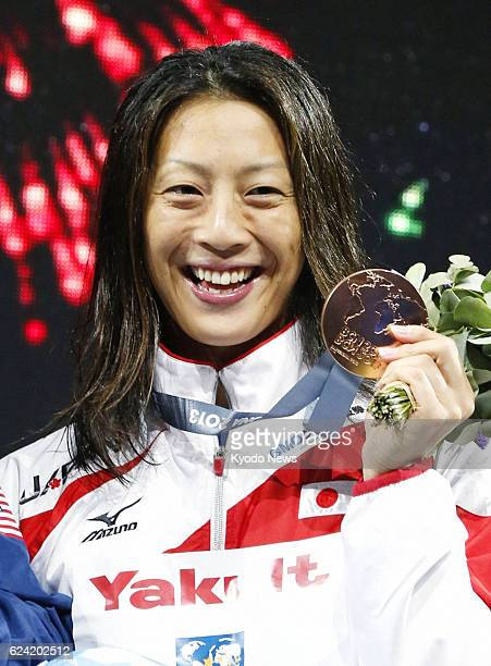 BARCELONA Spain Aya Terakawa of Japan smiles after winning the bronze of the women's 100meter backstroke at the world swimming championships in...