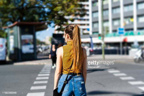 spain, back view of a teenage girl on the street in summer - one teenage girl only stock pictures, royalty-free photos & images