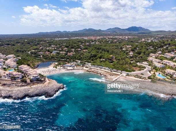 spain, baleares, mallorca, porto colom, aerial view of cala tropicana and cala domingo - domingo fotografías e imágenes de stock