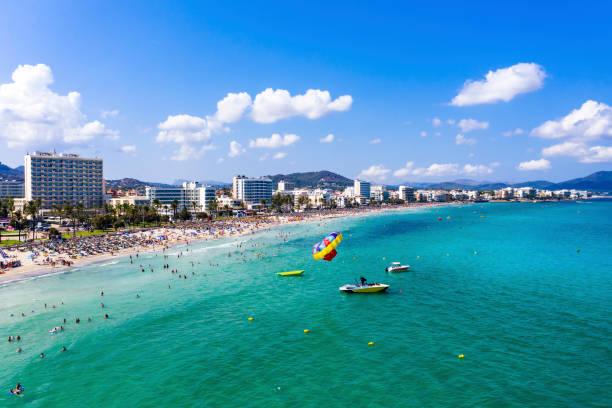 Spain, Balearic Islands, Cala Bona, Aerial view of coastline of resort town in summer