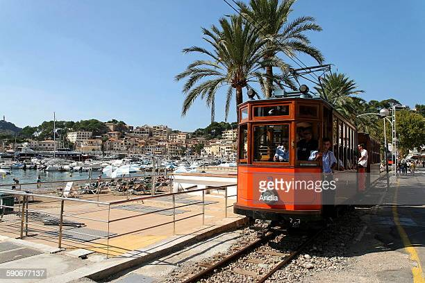 Balearic Islands Majorca Tram in the harbour of Soller tourist train linking Soller with Palma Majorca Palm trees beach city town seaside