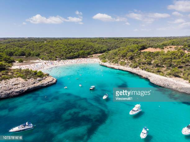 spain, balearic islands, mallorca, aerial view of cala mondrago and playa mondrago, mandrago nature park - majorca stock pictures, royalty-free photos & images