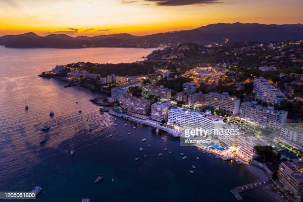 spain, balearic islands, mallorca, calvia region, aerial view over costa de la calma and santa ponca with hotels and beaches at sunset - majorca stock pictures, royalty-free photos & images