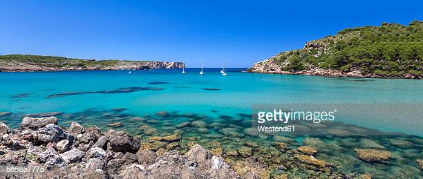 Spain, Balearic Islands, Menorca, view of La Vall beach with sailing boats, panorama